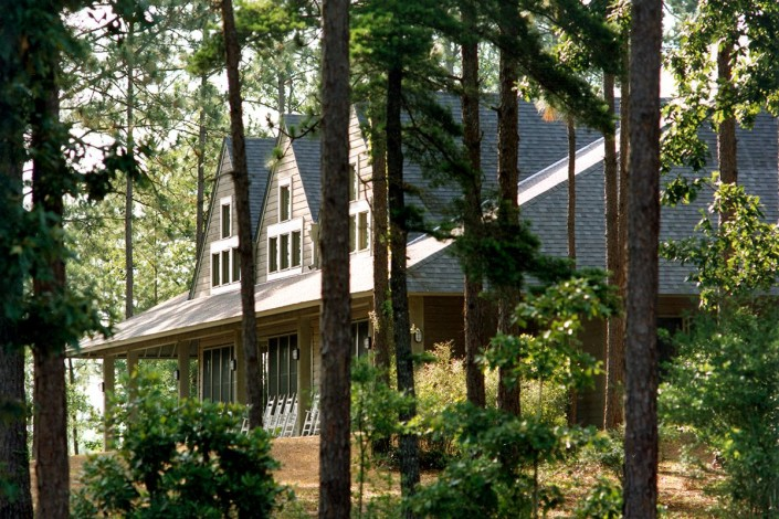 facade through pine trees of Hospitality Construction Episcopal Conference Center | DonahueFavret General Contractors | Louisiana and Gulf South